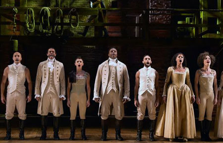 The cast of Hamilton performs at the 58th Grammy Awards