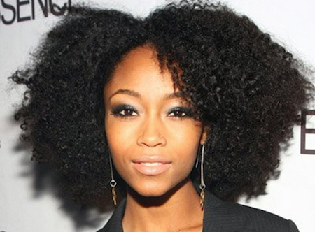 YaYa DaCosta showcases her natural curls.