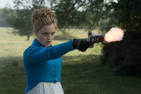 Jane (Bella Heathcote) shoots at a zombie