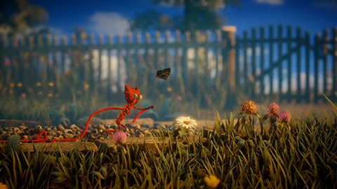 Yarny tries to catch a butterfly.
