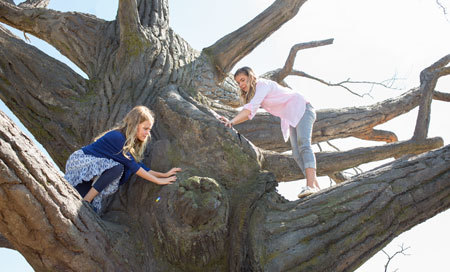Anna (Kylie) and big sister climb a tree