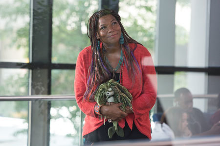 Angela (Queen Latifah) clutches Anna's mermaid doll