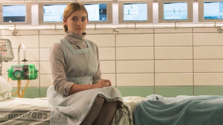 Prim in her nurse uniform