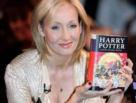 J.K. Rowling with Harry Potter and the Deathly Hallows book