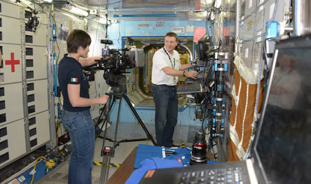 Astronauts set up a shot on the station