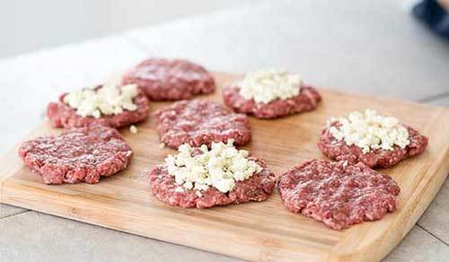 Layer the cheese between two patties