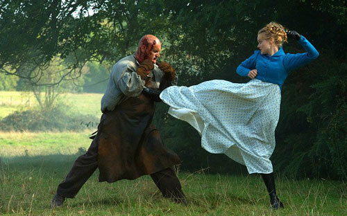 Bella Heathcote fights a big zombie