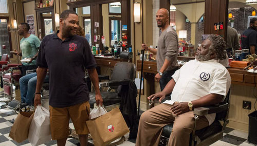 J.D. (Anthony Anderson) brings lunch to Eddie and gang
