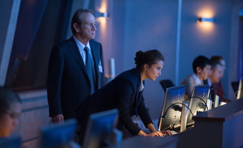 Alicia Vikander as Heather with Tommy Lee Jones CIA Director Dewey