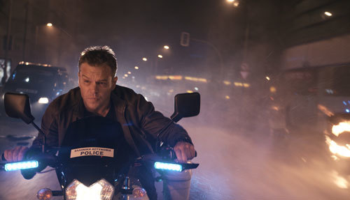 Bourne steals a police cycle to make a getaway