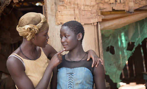 Harriet (Lupita) tells daughter Fiona (Madina) to keep her dreams in check