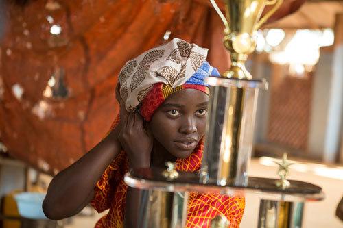 Phiona's mom Harriet (Lupita Nyong'o) hopes to make money for the family