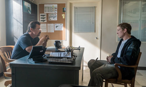 Supe (Josh Brolin) interviews Brendan (Miles Teller)