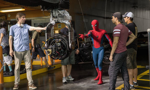 Spidey (Tom Holland) with director Jon Watts on set