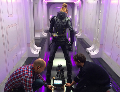 Cara as Laureline gets rigged up for a fight