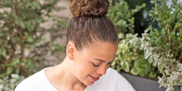 Put your hair in a top knot to hide the cut