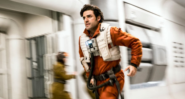 Poe Dameron rushes to his X-wing fighter