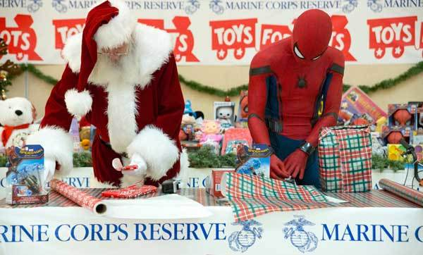 Santa wrapping presents with Spider-Man