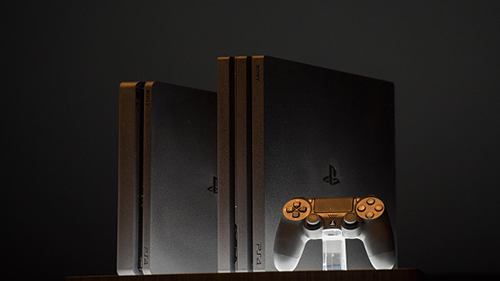 The new PlayStation 4 next to the Pro model.