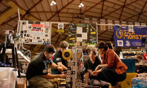 Robotics Club kids work on robot Stinky