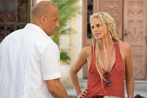 Dom (Vin Diesel) aids a mystery woman (Charlize Theron)