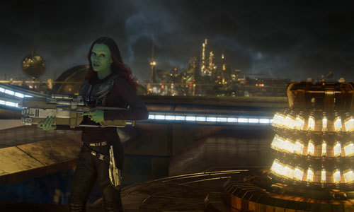 Gamora armed with a high tech gun