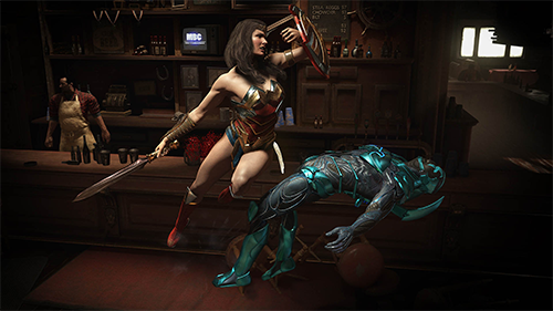 Wonder Woman takes down the Blue Beetle.