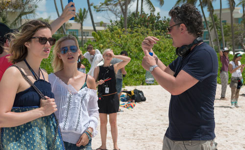 Mandy and Claire on the beach with their director