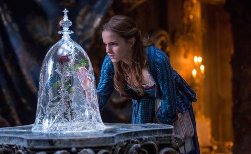 Belle (Emma Watson) discovers the enchanted rose