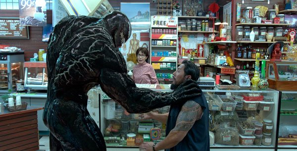 Venom threatens a bad guy