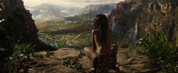 Mowgli looks at the village of Men below