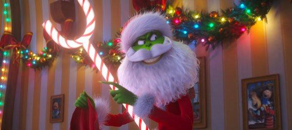 The Grinch poses as Santa