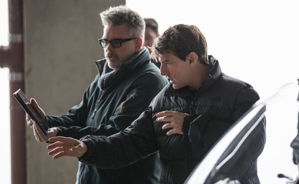 Tom looks at a scene with director Chris McQuarrie