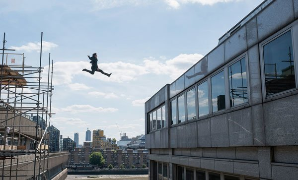 Tom leaps tall buildings in a single bound