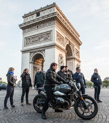 Tom with crew planning race in Paris
