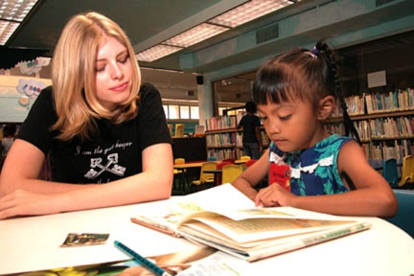 Love working with kids? Preschools and libraries can pair you with kids you can read to.