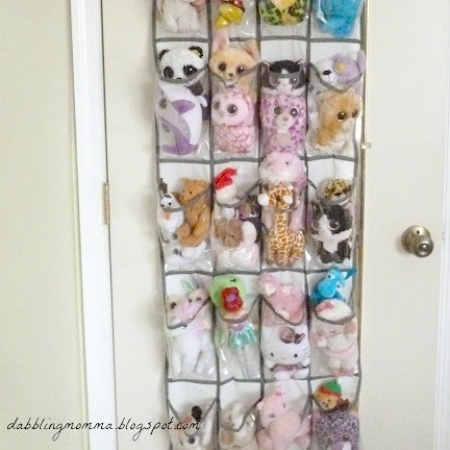 A behind the door shoe organizer tucks away stuffed animals in plain sight