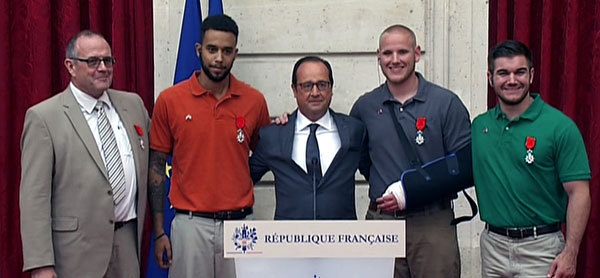 The guys get medals from the President of France