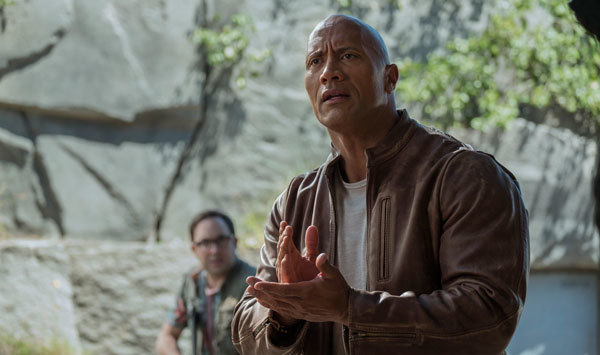 Davis (Dwayne Johnson) uses sign language with George