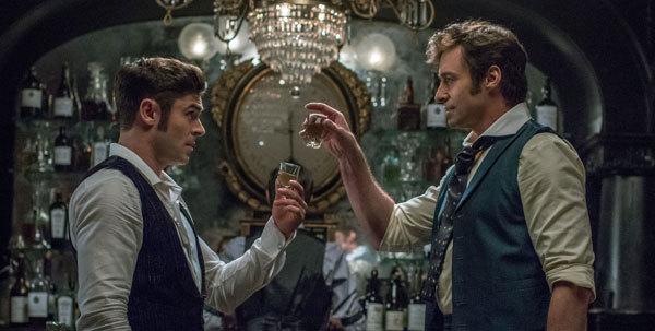 Barnum talks Phillip (Zac Efron) into becoming his partner