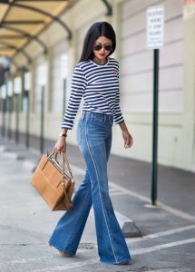 A pair of flared jeans adds flair to an ordinary outfit