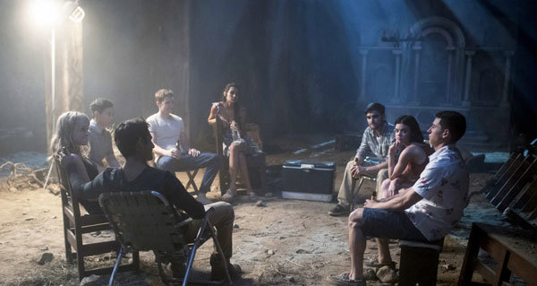 The friends play Truth or Dare (Lucy as Olivia, second from right)