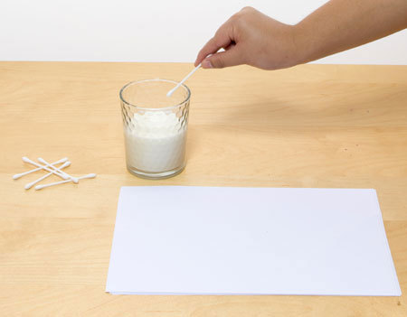 Use a q-tip and milk to make invisible ink