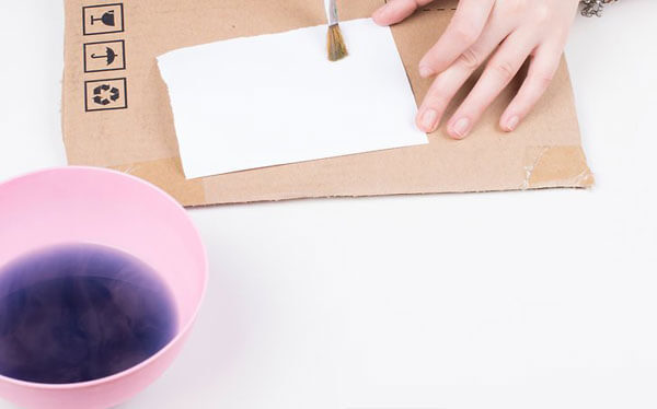 Use grape juice to reveal your message using baking soda as invisible ink