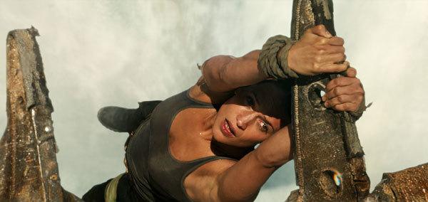 Lara hangs over the rapids