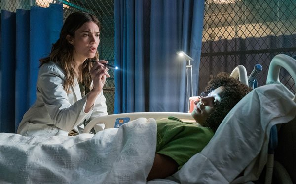 A doctor (Mandy Moore) first checks out Ruby in camp