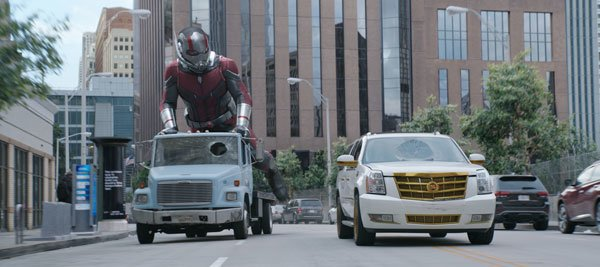 Giant Ant-Man about to use a truck for a skateboard