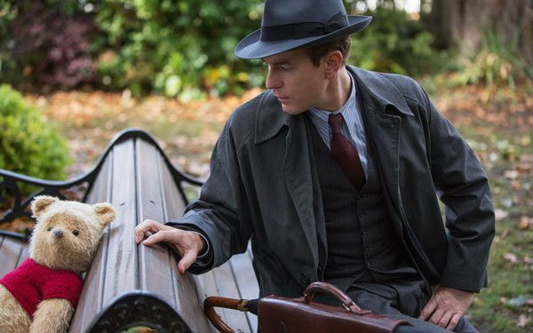 Christopher discovers Pooh on the park bench