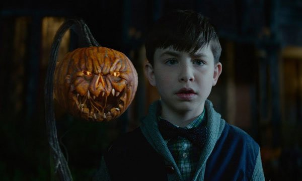 Lewis with one of the creepy jack-o-lanterns in background