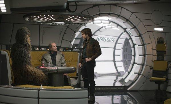 Chewie, Han and Beckett discuss a partnership